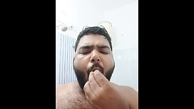 Indian guy fucking his face with cucumber